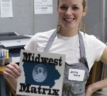 U. Iowa grad student, Jenny Harp, shows off a print made during the Midwest Matrix symposium.