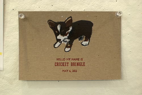 A print that welcomes Penland neighbor Edwina Bringle's new corgi puppy Cricket to the family