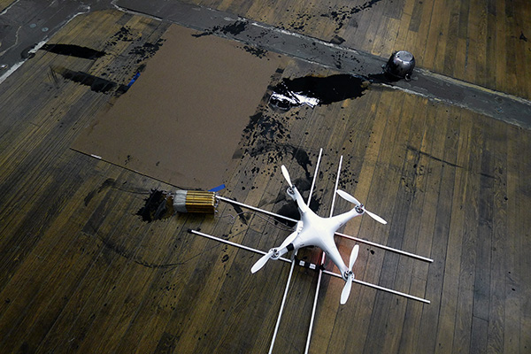Many test flights resulted in crashes due to the imbalance / pendulum-action of the brushes.  Heavier brushes on long chain particularly interrupted the drones ability to remain level (and airborne).