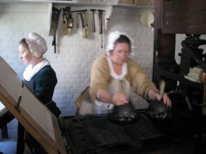 Lady_working_colonial_print_shop