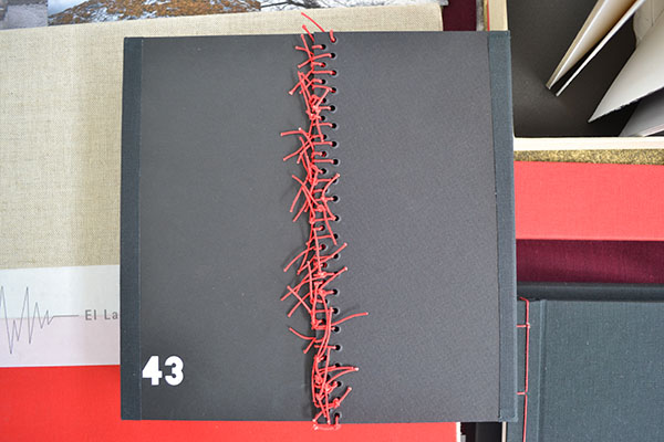 """Cover detail. The following is a small preview of the Artist book """"43 (cuarenta y tres)""""  from Mexican Artist  Lorena Velazquez. The book is a reflection on the events regarding the disappearance of the 43 students from Ayotzinapa Mexico."""